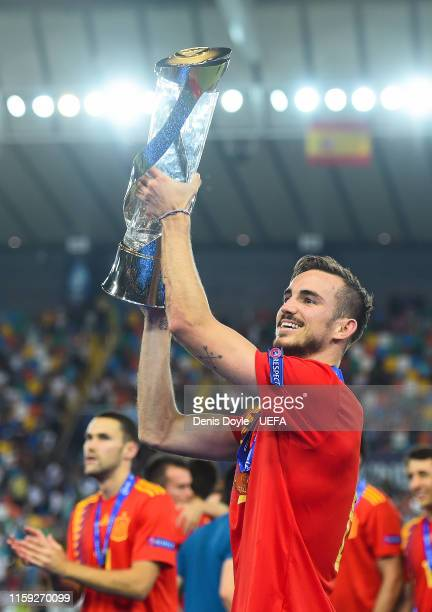 Fabian Ruiz of Spain celebrates with the trophy winning the 2019 UEFA U21 Final between Spain and Germany at Stadio Friuli on June 30 2019 in Udine...