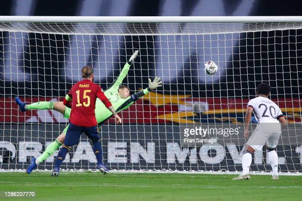 Fabian Ruiz of Spain scores his team's third goal against Manuel Neuer of Germany during the UEFA Nations League group stage match between Spain and...