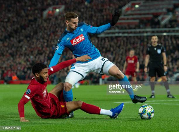 Fabian Ruiz of SSC Napoli and Joe Gomez of Liverpool in action during the UEFA Champions League group E match between Liverpool FC and SSC Napoli at...