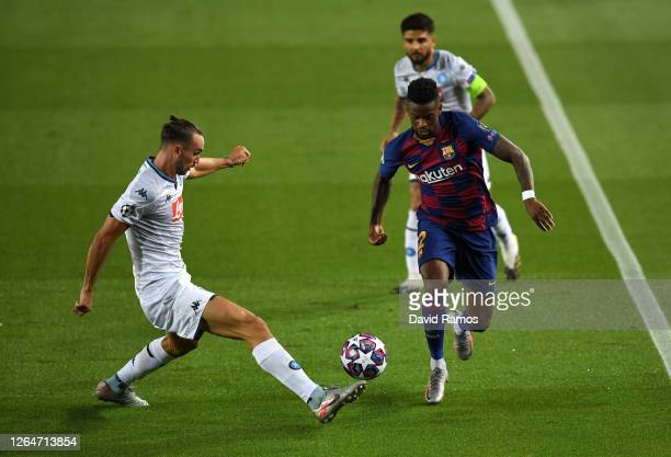 Fabian Ruiz of SSC Napoli battles for possession with Nelson Semedo of Barcelona during the UEFA Champions League round of 16 second leg match...