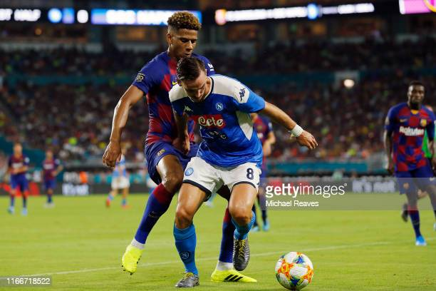Fabian Ruiz of SSC Napoli battles for the ball with JeanClair Todibo of FC Barcelona during a preseason friendly match at Hard Rock Stadium on August...