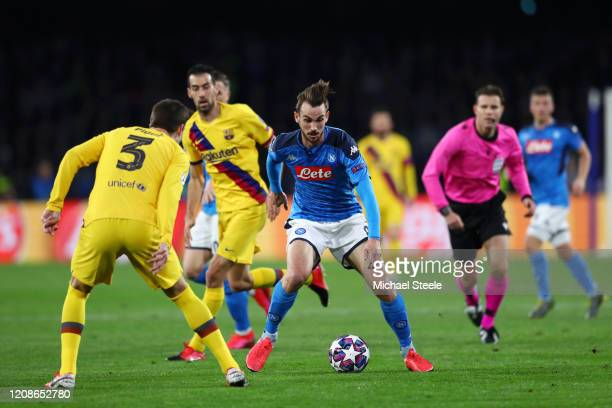 Fabian Ruiz of SSC Napoli is challenged by Gerard Pique of FC Barcelona during the UEFA Champions League round of 16 first leg match between SSC...