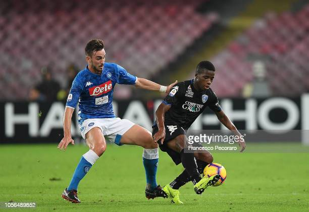 Fabian Ruiz of SSC Napoli vies Hamed Junior Traorè of Empoli during the Serie A match between SSC Napoli and Empoli at Stadio San Paolo on November 2...