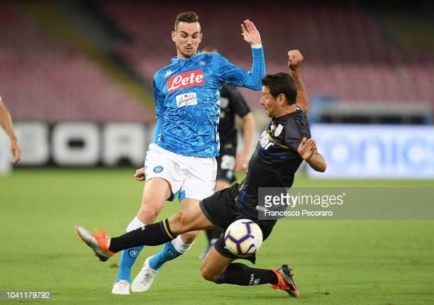 Fabian Ruiz of SSC Napoli vies Massimo Gobbi of Parma Calcio during the serie A match between SSC Napoli and Parma Calcio at Stadio San Paolo on...