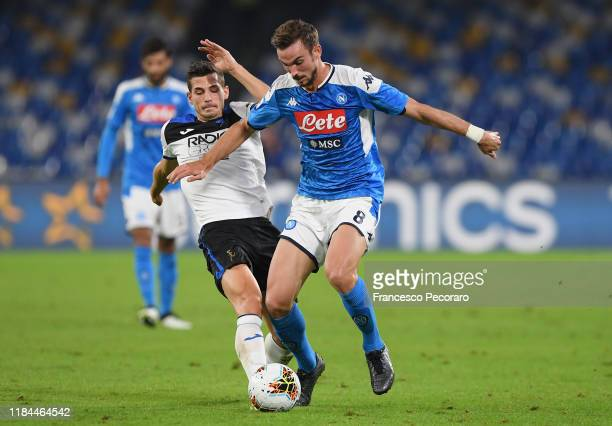 Fabian Ruiz of SSC Napoli vies with Remo Freuler of Atalanta BC during the Serie A match between SSC Napoli and Atalanta BC at Stadio San Paolo on...