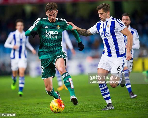 Fabian Ruiz Pena of Real Betis Balompie duels for the ball with Inigo Martinez of Real Sociedad during the La Liga match between Real Sociedad de...