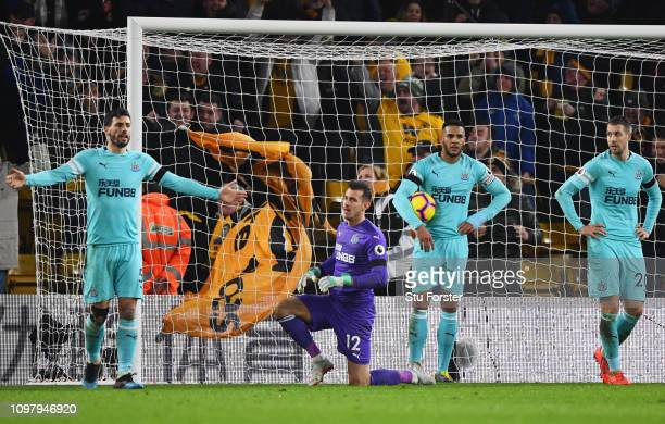 Fabian Schaer Martin Dubravka Jamaal Lascelles and Florian Lejeune of Newcastle United react as Willy Boly of Wolverhampton Wanderers scores his...