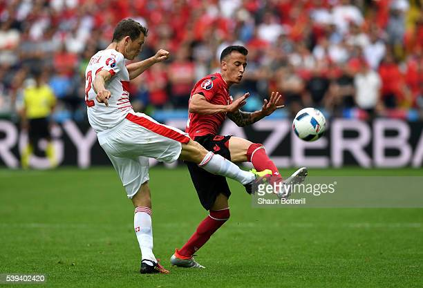 Fabian Schaer of Switzerland and Ergys Kace of Albania compete for the ball during the UEFA EURO 2016 Group A match between Albania and Switzerland...
