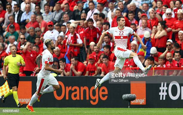 Fabian Schaer of Switzerland celebrates scoring his team's first goal with his team mate Valon Behrami during the UEFA EURO 2016 Group A match...