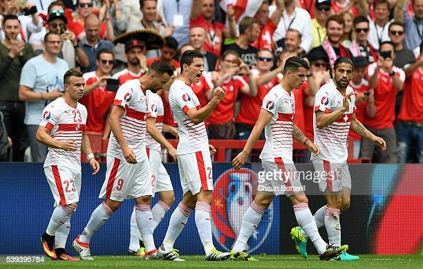 Fabian Schaer of Switzerland celebrates scoring his team's first goal with his team matesduring the UEFA EURO 2016 Group A match between Albania and...