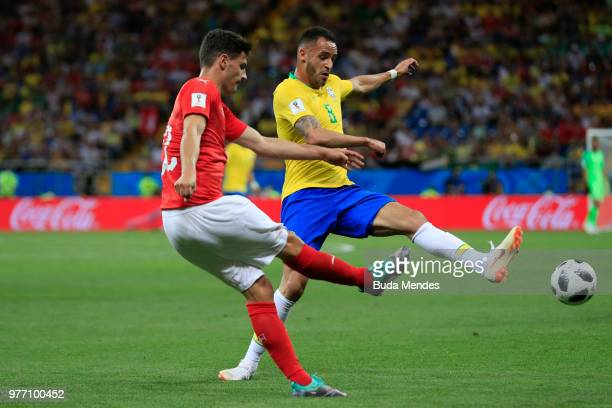 Fabian Schaer of Switzerland challenge for the ball with Renato Augusto of Brazil during the 2018 FIFA World Cup Russia group E match between Brazil...