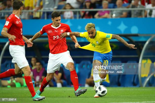 Fabian Schaer of Switzerland challenges Neymar of Brazil during the 2018 FIFA World Cup Russia group E match between Brazil and Switzerland at Rostov...