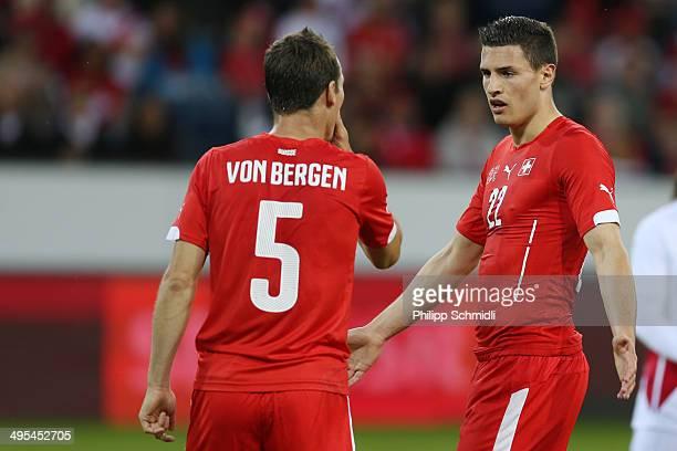 Fabian Schaer of Switzerland speaks to Steve Von Bergen during the international friendly match between Switzerland and Peru at Swissporarena on June...