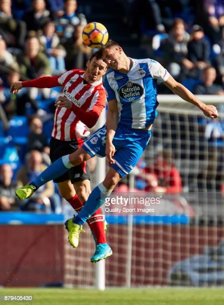 Fabian Schar of Deportivo de La Coruna competes for the ball with Aritz Aduriz of Athletic de Bilbao during the La Liga match between Deportivo La...