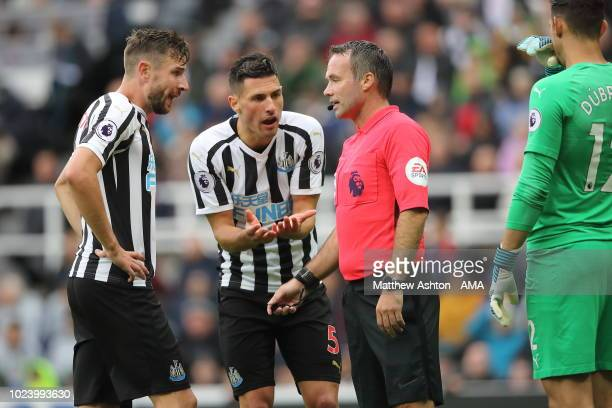 Fabian Schar of Newcastle United agues with referee Paul Tierney after he awarded a penalty for a foul on Marcos Alonso of Chelsea during the Premier...
