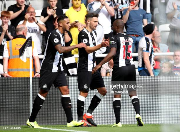 Fabian Schar of Newcastle United celebrates with teammates after scoring his team's first goal during the Premier League match between Newcastle...