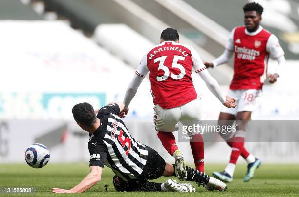 Fabian Schar of Newcastle United fouls Gabriel Martinelli of Arsenal leading to a red card being shown during the Premier League match between...