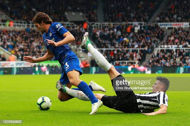 Fabian Schar of Newcastle United fouls Marcos Alonso of Chelsea and a penalty is awarded during the Premier League match between Newcastle United and...