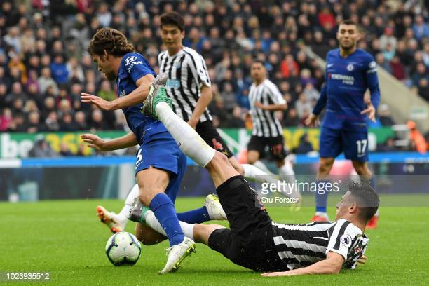 Fabian Schar of Newcastle United fouls Marcos Alonso of Chelsea inside of the penalty area leading to Chelsea being awarded a penalty during the...