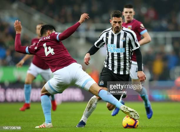 Fabian Schar of Newcastle United is challenged by Fabian Balbuena of West Ham United during the Premier League match between Newcastle United and...