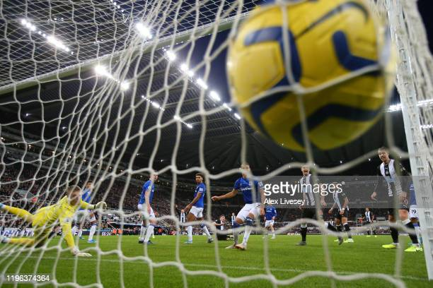 Fabian Schar of Newcastle United scores his team's first goal past Jordan Pickford of Everton during the Premier League match between Newcastle...