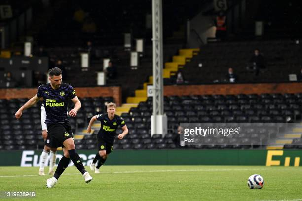 Fabian Schar of Newcastle United scores his team's second goal from a penalty during the Premier League match between Fulham and Newcastle United at...