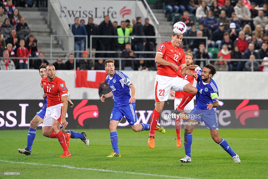 Fabian Schar of Switzerland and Alessandro Della Valle of San Marino during the UEFA EURO 2016 qualifier between Switzerland and San Marino at AFG Arena on October 9, 2015 in St Gallen, Switzerland.