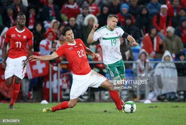 Fabian Schar of Switzerland Jamie Ward of Northern Ireland during the FIFA 2018 World Cup Qualifier PlayOff Second Leg between Switzerland and...