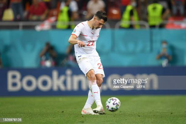 Fabian Schar of Switzerland scores their team's second penalty in a penalty shoot out during the UEFA Euro 2020 Championship Round of 16 match...