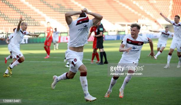 Fabian Schleusener of Nuremberg celebrates after scoring his teams first goal during the 2 Bundesliga playoff second leg match between FC Ingolstadt...