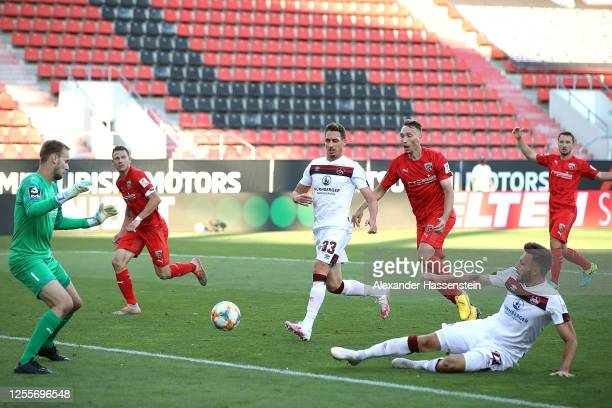 Fabian Schleusener of Nuremberg scores his teams first goal during the 2. Bundesliga playoff second leg match between FC Ingolstadt and 1. FC...