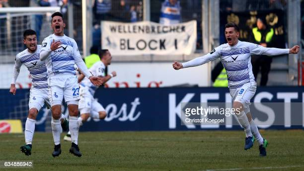 Fabian Schnellhardt of Duisburg celebrates the third and decision goal with Dustin Bomheuer and Thomas Broeker of Duisburg during the Third League...