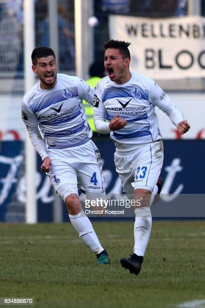 Fabian Schnellhardt of Duisburg celebrates the third goal with Dustin Bomheuer of Duisburg during the Third League match between MSV Duisburg and...