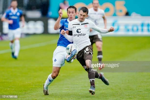 Fabian Schnellhardt of SV Darmstadt 98 battles for possession with Waldemar Sobota of FC St. Pauli during the Second Bundesliga match between SV...