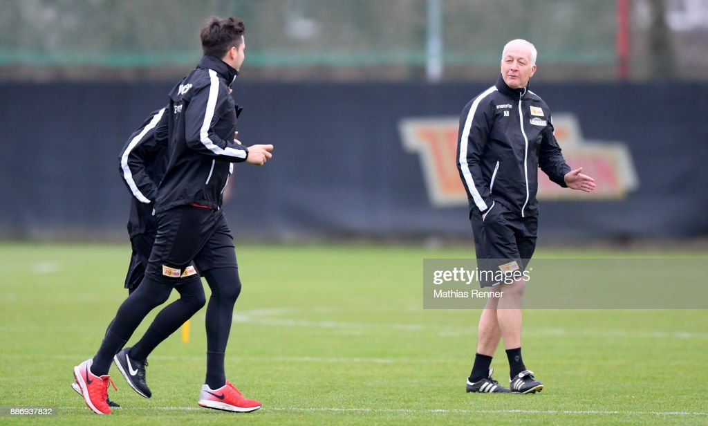 Fabian Schoenheim and Coach Andre Hofschneider of Union Berlin during the training session on December 6, 2017 in Berlin, Germany.