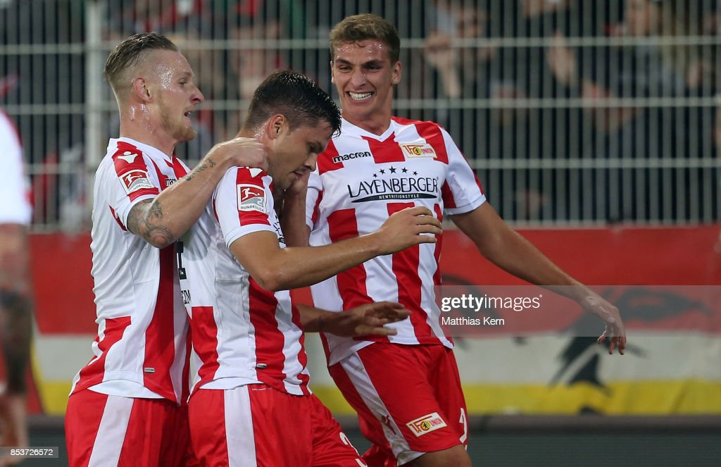 Fabian Schoenheim (C) of Berlin jubilates with team mates after scoring the second goal during the Second Bundesliga match between 1. FC Union Berlin and 1. FC Kaiserslautern at Stadion An der Alten Foersterei on September 25, 2017 in Berlin, Germany.