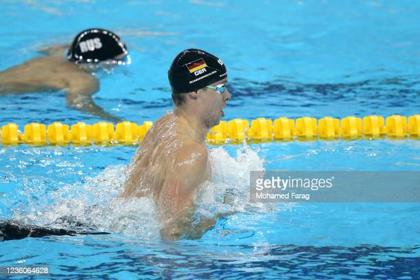 Fabian Schwingenschlogl of Germany competes in the Men's 200m Individual Breaststroke Heats during day Three of the FINA Swimming World Cup Doha at...