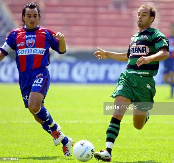 Fabian Staychilean player and captain of the Atlante fights for the ball with Joahan Rodriguez of Santos Torreon in Neza 86 Stadium in Nezahualcoyotl...