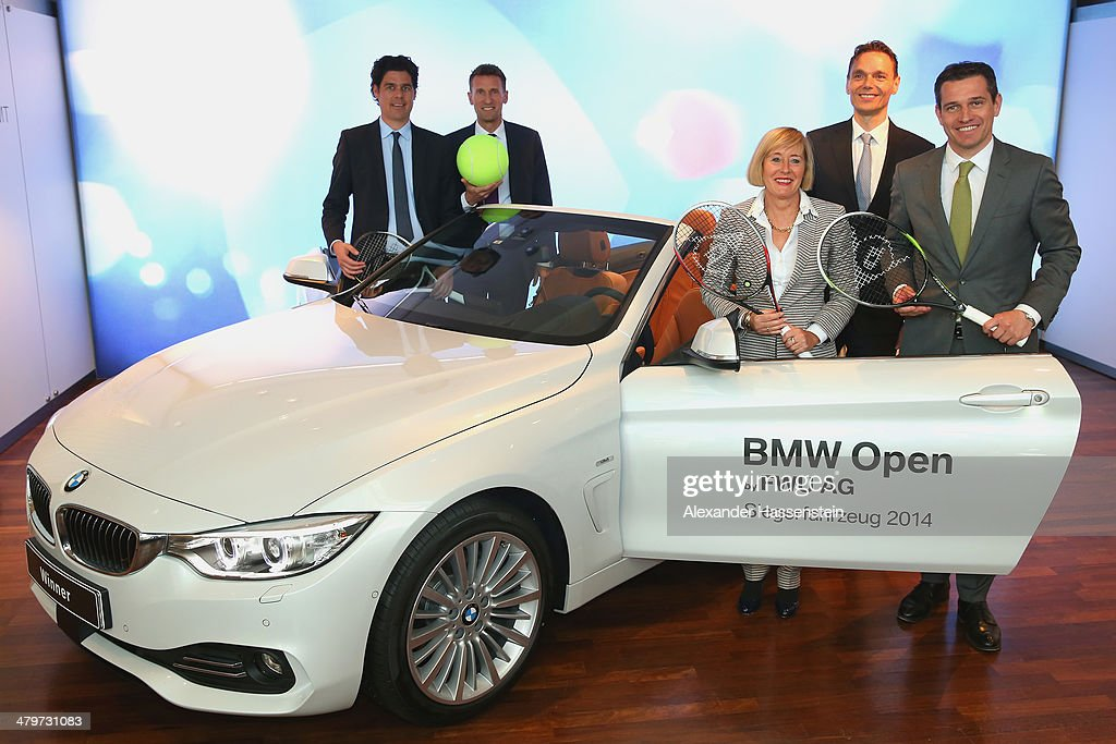 Fabian Tross, General Manager of Iphitos, Patrik Kuehnen, Turnament Director of BMW Open by FWU AG, Angela S. Dirrheimer, Member of the Board FWU AG, Roland Krueger, Senior Vice President and Head of Sales and Marketing BMW Germany and Michael Mronz, General Manager MMP pose with the winners car BMW 420d convetible after the BMW Open by FWU AG press conference by BMW Lenbachplatz on March 20, 2014 in Munich, Germany.