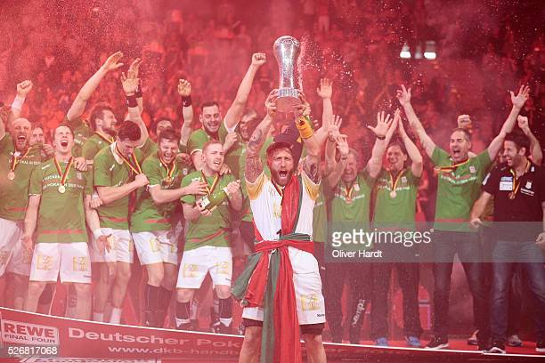 Fabian van Olphen of Magdeburg celebrate with the trophy after winning the DKB REWE Final Four Finale 2016 between SG Flensburg Handewitt and SC...