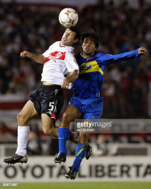 Fabian Vargas of Boca Juniors and Javier Mascherano of River Plate try to head the ball during a Libertadores Cup semifinal match 17 June at the...