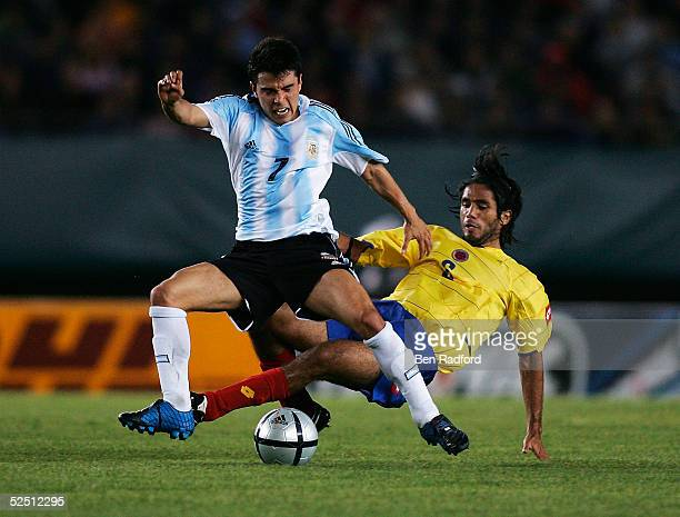 Fabian Vargas of Colombia clashes with Javier Saviola of Argentina during the 2006 World Cup qualifying match between Argentina and Colombia at The...