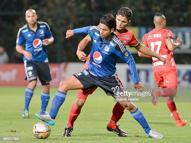 Fabian Vargas of Millonarios struggles for the ball with Larry Vasquez of Patriotas FC during a match between Patriotas FC and Millonarios as part of...