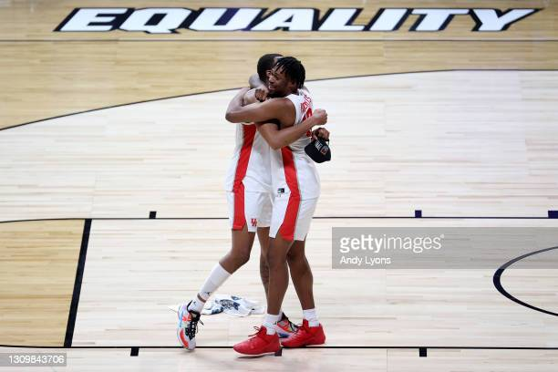 Fabian White Jr. #35 of the Houston Cougars and J'Wan Roberts celebrate after defeating the Oregon State Beavers during the second half in the Elite...