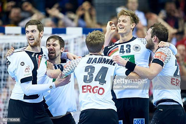 Fabian Wiede and Niclas Pieczkowski and Rune Dahmke and Steffen Fath all from Germany celebrates after their victory during the Men's EHF Handball...