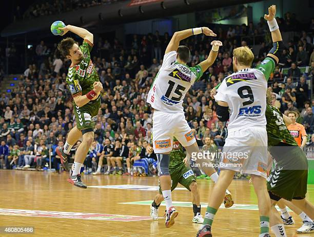 Fabian Wiede of Fuechse Berlin Zarko Sesum and Manuel Spaeth of Frisch Auf Goeppingen in action during the game between Fuechse Berlin and Frisch Auf...