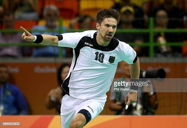 Fabian Wiede of Germany celebrates a goal during the Men's Preliminary Group B match between Sweden and Germany at on Day 2 of the Rio 2016 Olympic...