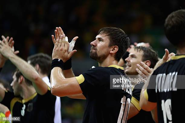 Fabian Wiede of Germany celebrates their victory following the Men's Bronze Medal Match between Poland and Germany on Day 16 of the Rio 2016 Olympic...
