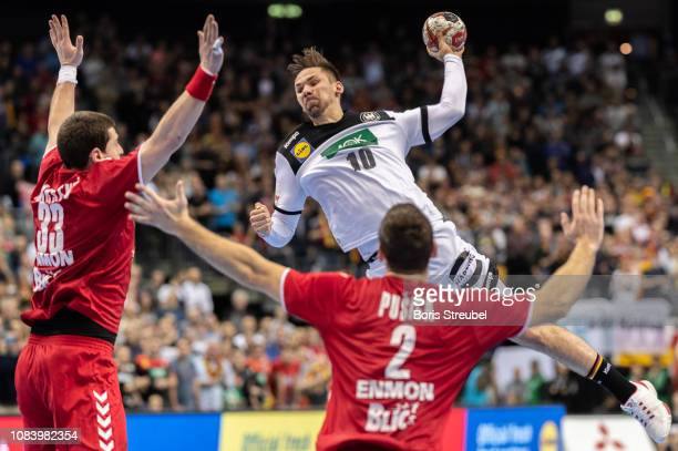 Fabian Wiede of Germany in action with Mijajlo Marsenic of Serbia and Miljan Pusica of Serbia during the 26th IHF Men's World Championship group A...