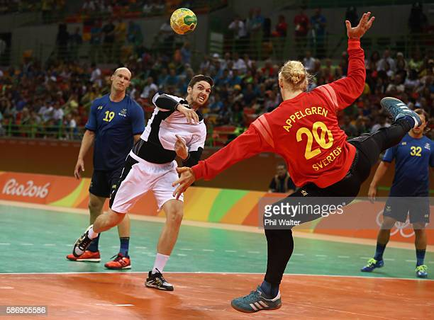 Fabian Wiede of Germany shoot against goalkeeper Mikael Appelgren of Sweden during the Men's Preliminary Group B match between Sweden and Germany at...